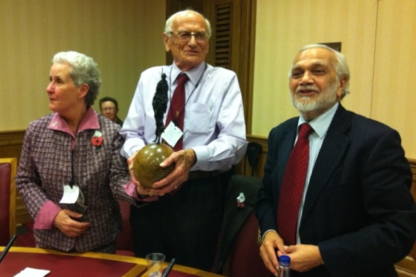 Godric Bader (centre) accompanied by his wife Anne Atkinson-Clark (left) receiving the Gandhi Foundation International Peace Award 2014 from our President Lord Bhikhu Parekh (right). Photo coutesy of Tariq Chawdry of the Gandhi Resource Foundation